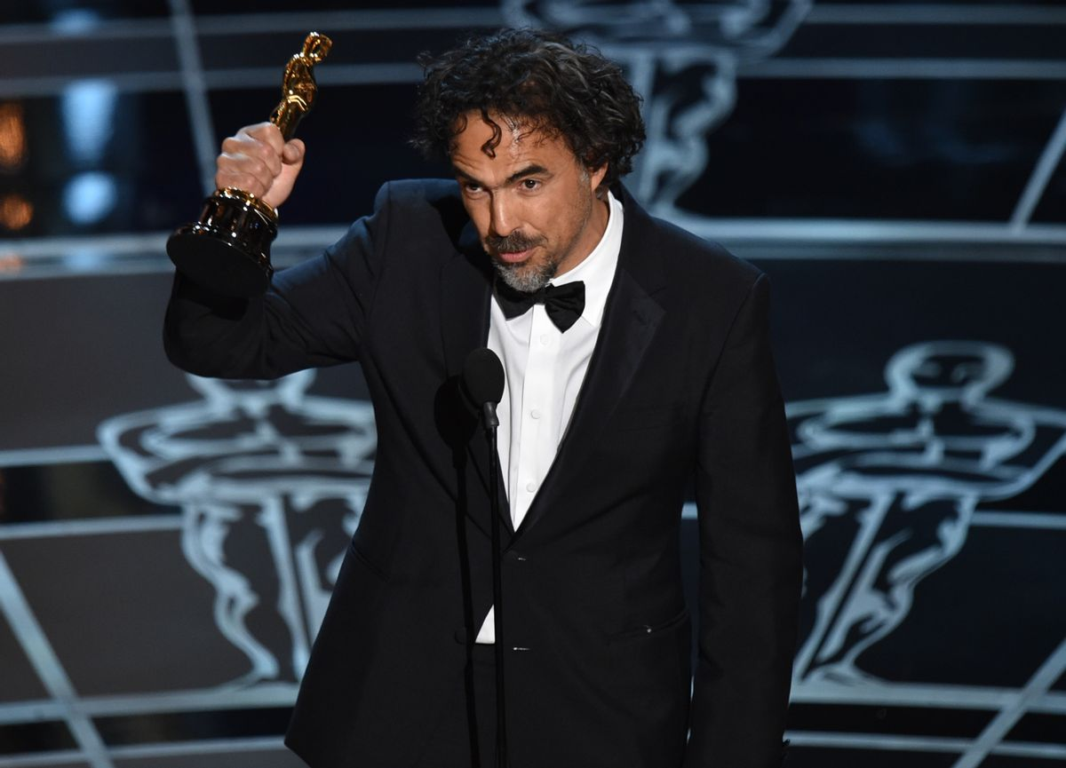 """Alejandro G. Inarritu accepts the award for best director for """"Birdman or (The Unexpected Virtue of Ignorance)"""" at the Oscars on Sunday, Feb. 22, 2015, at the Dolby Theatre in Los Angeles. (Photo by John Shearer/Invision/AP)   (John Shearer/invision/ap)"""