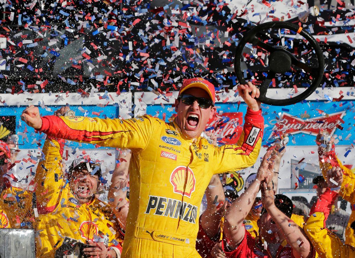 Joey Logano celebrates in Victory Lane after winning the Daytona 500 NASCAR Sprint Cup series auto race at Daytona International Speedway, Sunday, Feb. 22, 2015, in Daytona Beach, Fla. (AP Photo/Chuck Burton) (AP)