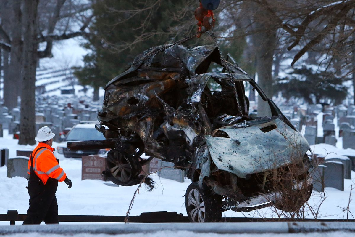 Emergency personnel work to remove the wreckage of a deadly SUV and commuter train accident in Valhalla, N.Y., Wednesday, Feb. 4, 2015. A packed Metro-North Railroad train slammed into a SUV on the tracks and erupted into flames Tuesday night, killing some and injuring others, sending hundreds of passengers scrambling for safety, authorities said. (AP Photo/Jason DeCrow) (AP)