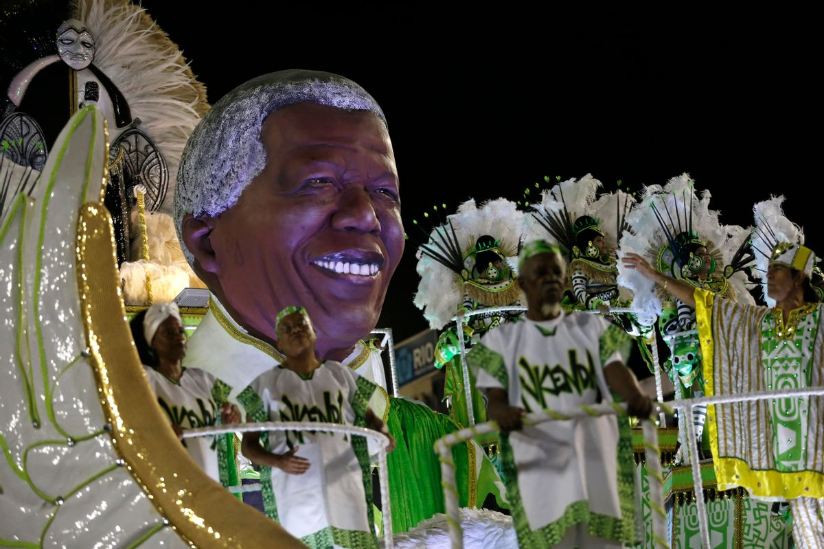 Performers from the Imperatriz Leopoldinense samba school parade on a float with an sculpture in the likeness of Nelson Mandela during carnival celebrations at the Sambadrome in Rio de Janeiro, Brazil, Tuesday, Feb. 17, 2015. (AP Photo/Silvia Izquierdo) (AP)