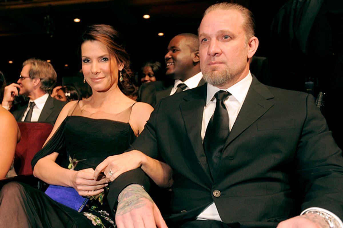 Sandra Bullock with then husband Jesse James, Feb. 26, 2010.     (AP/Chris Pizzello)
