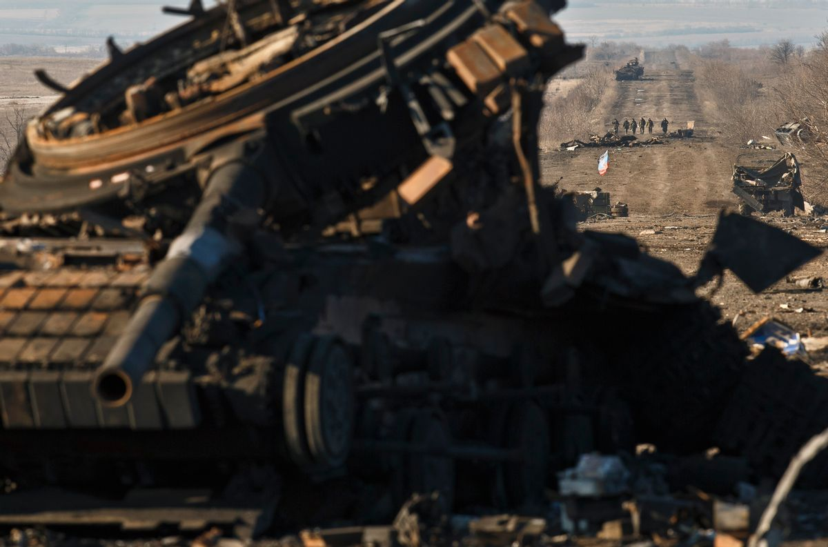 FILE - In this Sunday Feb. 22, 2015 file photo, Russia-backed separatists walk along a road that takes them to Artemivsk, littered with destroyed Ukrainian army tanks and vehicles, outside Debaltseve, Ukraine. (AP Photo/Vadim Ghirda, File) (AP)