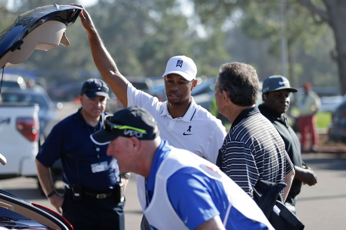 Tiger Woods loads his car after withdrawing in the first round of the Farmers Insurance Open golf tournament Thursday, Feb. 5, 2015, in San Diego. (AP Photo/Gregory Bull) (AP)