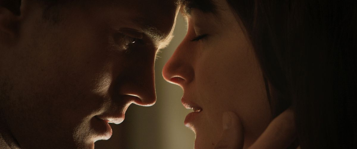 """Jamie Dornan and Dakota Johnson in a scene from """"Fifty Shades of Grey.""""  (AP/Universal Pictures and Focus Pictures)"""