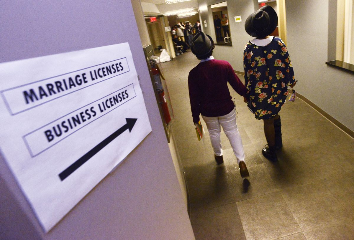 Shante Wolfe, left, and Tori Sisson walk to get their marriage license at the Montgomery County Probate Office in Montgomery, Ala. on Monday, Feb. 9, 2015.  (AP/Montgomery Advertiser, Mickey Welsh)