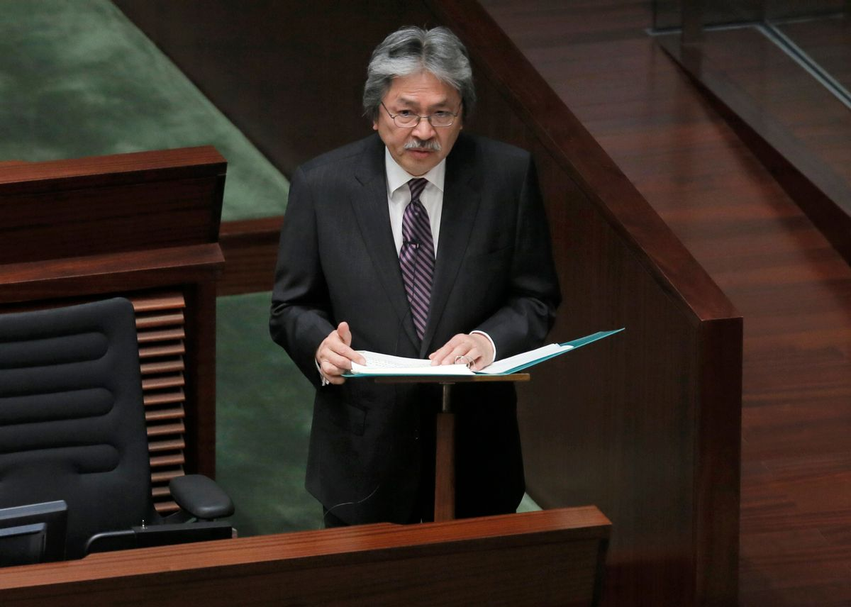 Hong Kong's Financial Secretary John Tsang delivers his annual budget speech at the Legislative Counci in Hong Kong Wednesday, Feb. 25, 2015. Tsang   unveiled $37 million in measures aimed at giving relief to some business owners and restoring confidence in the Asian financial hub following pro-democracy protests last year that choked traffic for 11 weeks. (AP Photo/Vincent Yu) (Vincent Yu)
