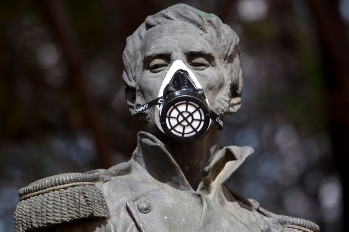A gas mask covers the mouth on the statue of independence hero Leonardo Bravo in Mexico City, Feb. 28, 2012.      (AP/Eduardo Verdugo)