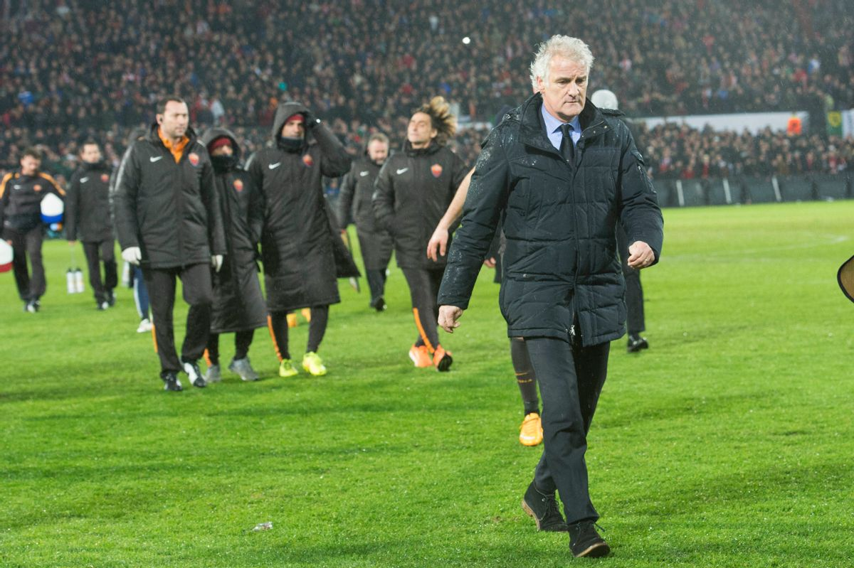 PSV head coach Fred Tutten leaves the pitch after Referee Clement Cano from France ceased  an Europa  League round of 32 second leg soccer match between Feyenoord and AS Roma, at De Kuip stadium in Rotterdam, Netherlands, Thursday Feb. 26, 2015. (AP Photo/Ermindo Armino) (AP)
