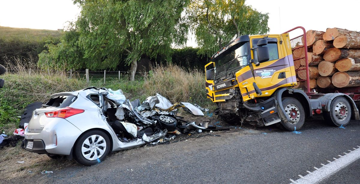 A small passenger car and a logging truck as seen after they collided head-on near Tokoroa, New Zealand, Tuesday Feb.  2015. Authorities said, U.S. citizens  Warren Lee, 53, and his wife Aesoon Lee, 52 and the couple's 20-year-old daughter, Julia Lee, were killed and their son critically injured when their car crashed into a logging truck.(AP Photo/NZ Herald/John van de Ven)**Australia Out New Zealand Out** (John Van De Ven)