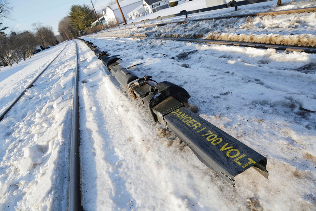 The electrified third rail, center, runs next to Metro-North Railroad tracks, Friday, Feb. 6, 2015, in Valhalla, N.Y. An SUV driver and five train passengers were killed Tuesday evening in a rush-hour collision in Valhalla. (AP Photo/Mark Lennihan) (AP)
