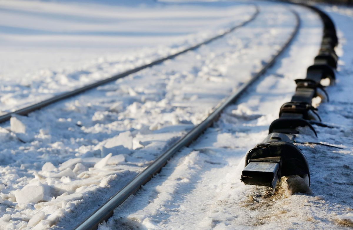 The electrified third rail, right, runs next to Metro-North Railroad tracks, Friday, Feb. 6, 2015, in Valhalla, N.Y. An SUV driver and five train passengers were killed Tuesday evening in a rush-hour collision in Valhalla. (AP Photo/Mark Lennihan) (AP)