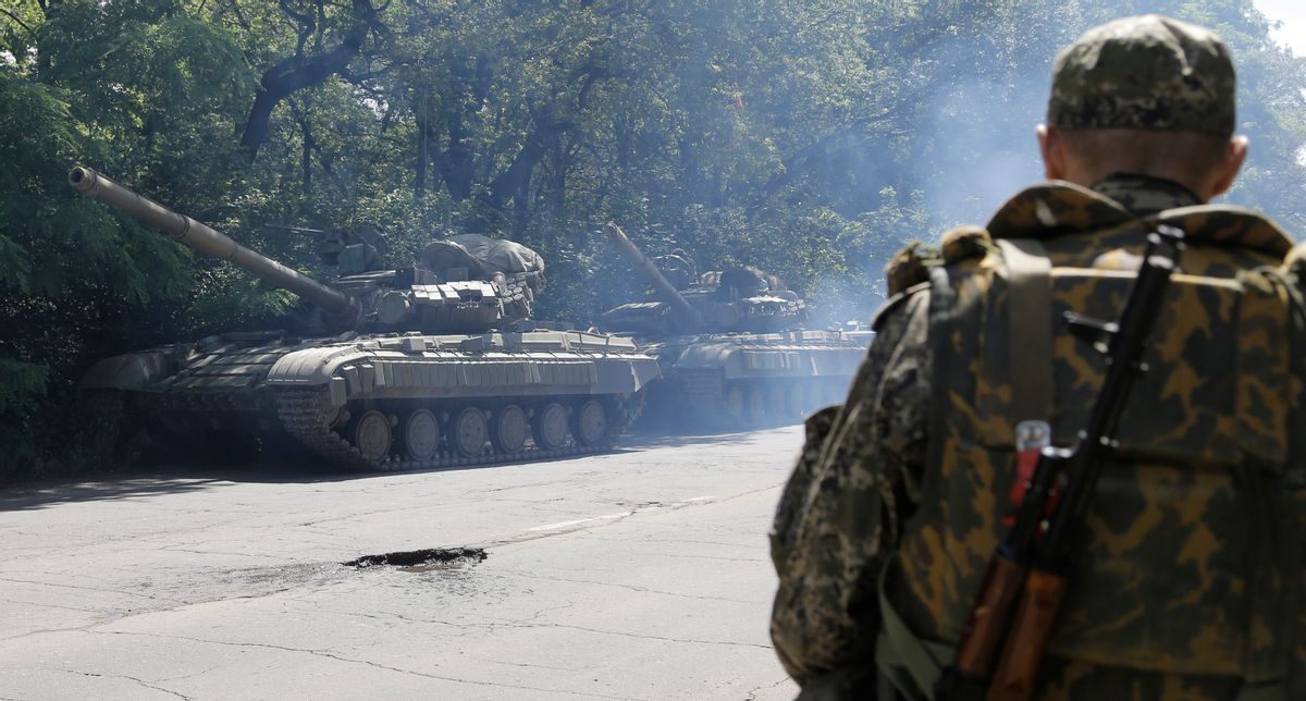 FILE- In this file photo taken on Friday, June  20, 2014, Pro-Russian troops prepare to travel in a tank on a road near the town of Yanakiyevo, Donetsk region, eastern Ukraine.  Russia has denied it is sending arms and troops to support the separatists in Ukraine,  but dozens of soldiers have been reported killed during drills in the Rostov region of southern Russia, but rights groups have actually attributed the deaths to the conflict over the border in Ukraine. (AP Photo/Dmitry Lovetsky, file) (AP)