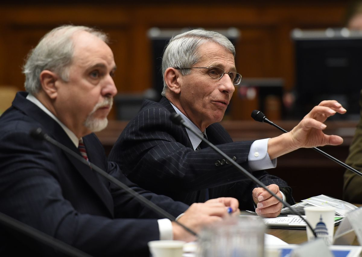 Dr. Anthony Fauci, right, Director, National Institute of Allergy and Infectious Diseases, National Institutes of Health, testifies next to Dr. Robin Robinson, Director Biomedical Advanced Research and Development Authority, U.S. Department of Health and Human Services, before the House Energy and Commerce subcommittee hearing looking into the effectiveness of vaccines in the wake of a measles outbreak and the exceptionally severe flu season, on Capitol Hill in Washington, Tuesday, February 3, 2015.  (AP Photo/Molly Riley) (AP)