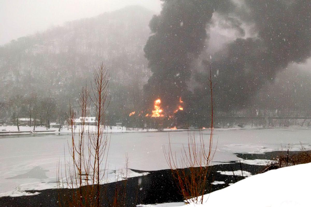 Fire burns at the scene of a train derailment, near Mount Carbon, W.Va, Feb. 16, 2015.   (AP/Bob Aaron)