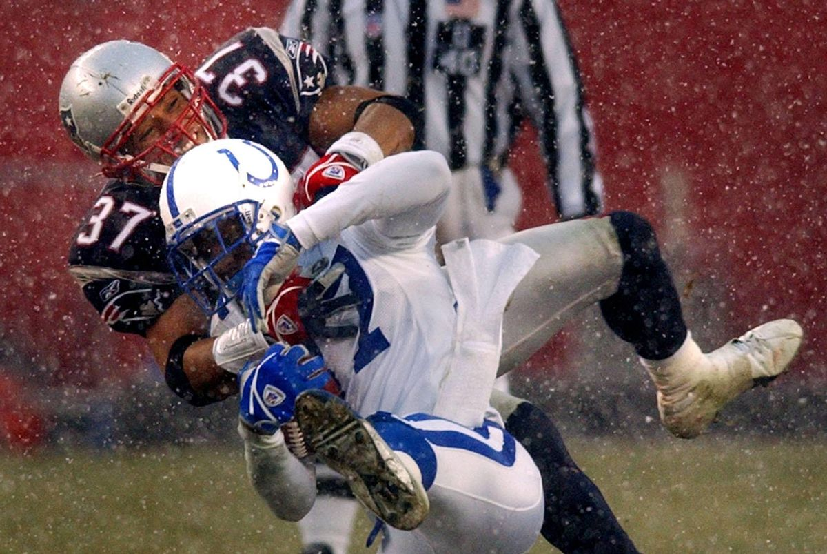 New England Patriots safety Rodney Harrison (37) takes down Indianapolis Colts wide receiver Reggie Wayne    (AP/Charles Krupa)