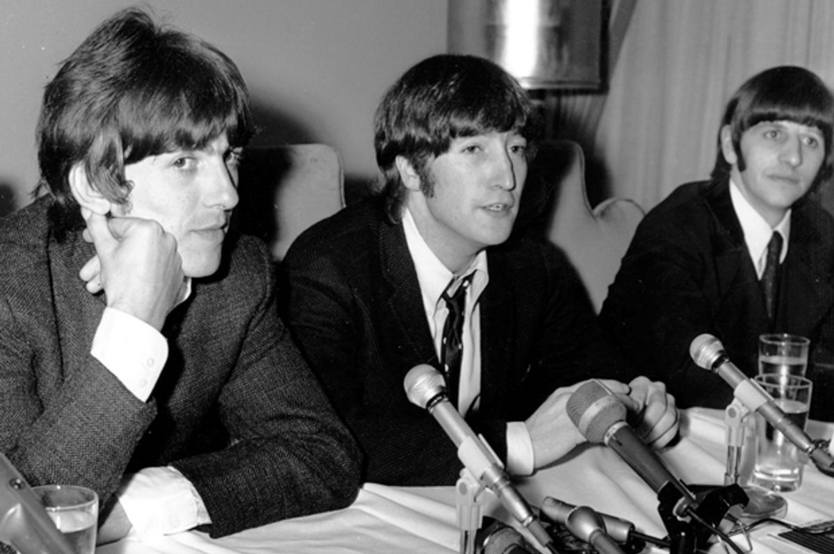 """John Lennon apologizes for his remark that """"the Beatles are more popular than Jesus,"""" at a Chicago news conference, Aug. 11, 1966.    (AP)"""