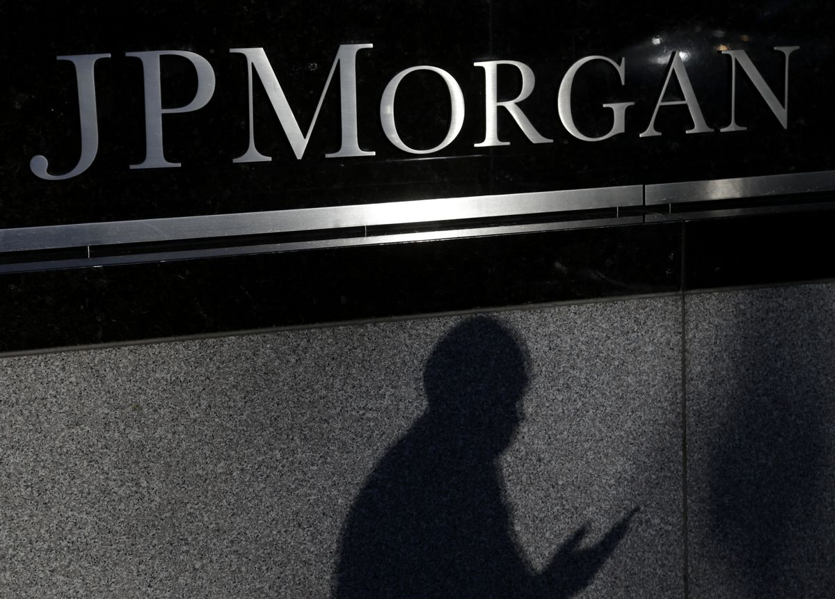 FILE - In this Nov. 19, 2013, file photo, the shadow of a pedestrian is cast under a sign in front of JPMorgan Chase & Co. headquarters in New York. After having just been awarded a multibillion-dollar settlement stemming from the financial crisis, the investment giant launched the hashtag (hash)AskJPM for people to ask career advice questions. But the move badly underestimated consumer sentiment toward banks and showed a tone of deafness to how social media works. (AP Photo/Seth Wenig, File) (AP)