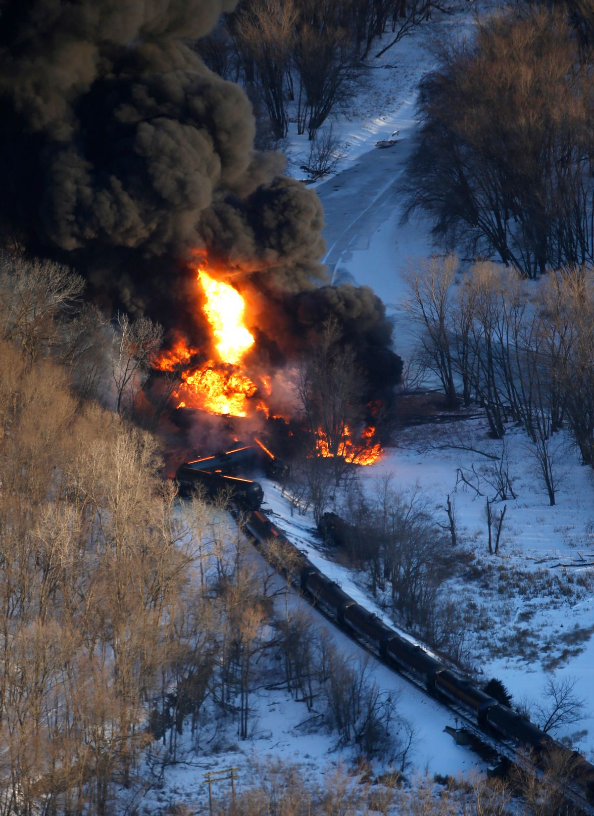 Smoke and flames erupt from the scene of a train derailment Thursday, March 5, 2015, near Galena, Ill. A BNSF Railway freight train loaded with crude oil derailed around 1:20 p.m. in a rural area where the Galena River meets the Mississippi, said Jo Daviess County Sheriff's Sgt. Mike Moser. (AP Photo/Telegraph Herald, Mike Burley)  (AP)