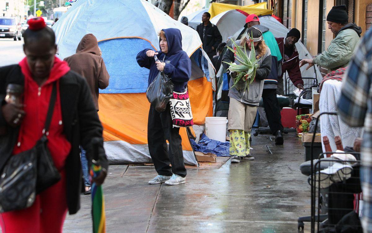 Skid Row residents start their morning, Monday, March 2, 2015. (AP Photo/Richard Vogel) (AP)