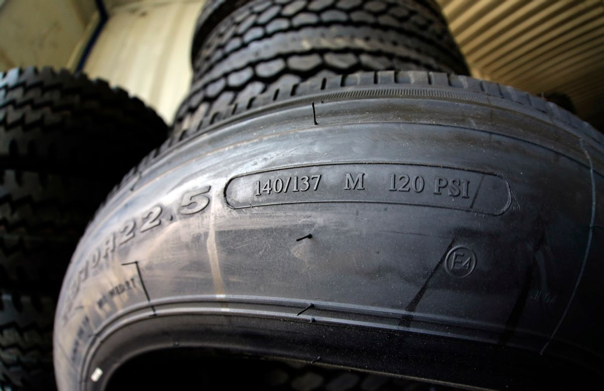 This March 18, 2015 photo shows the load index, 140/137, and speed rating, M, on a popular size semi-tractor trailer tire, at a truck tire shop in Houston. The M speed rating indicates that 81 mph is the maximum speed at which this tire can carry a load weighing 5,512 pounds at the recommended air pressure. (AP Photo/David J. Phillip) (AP Photo/David J. Phillip)