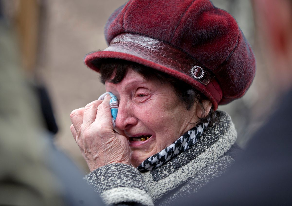 A woman cries as she waits to hear news about relatives after an explosion at  the Zasyadko coal mine in Donetsk, Ukraine Wednesday March 4, 2015.  An explosion took place underground at the Zasyadko coal mine in war-torn eastern Ukraine on Wednesday, an area controlled by pro-Russian rebels. (AP Photo/Vadim Ghirda) (AP)