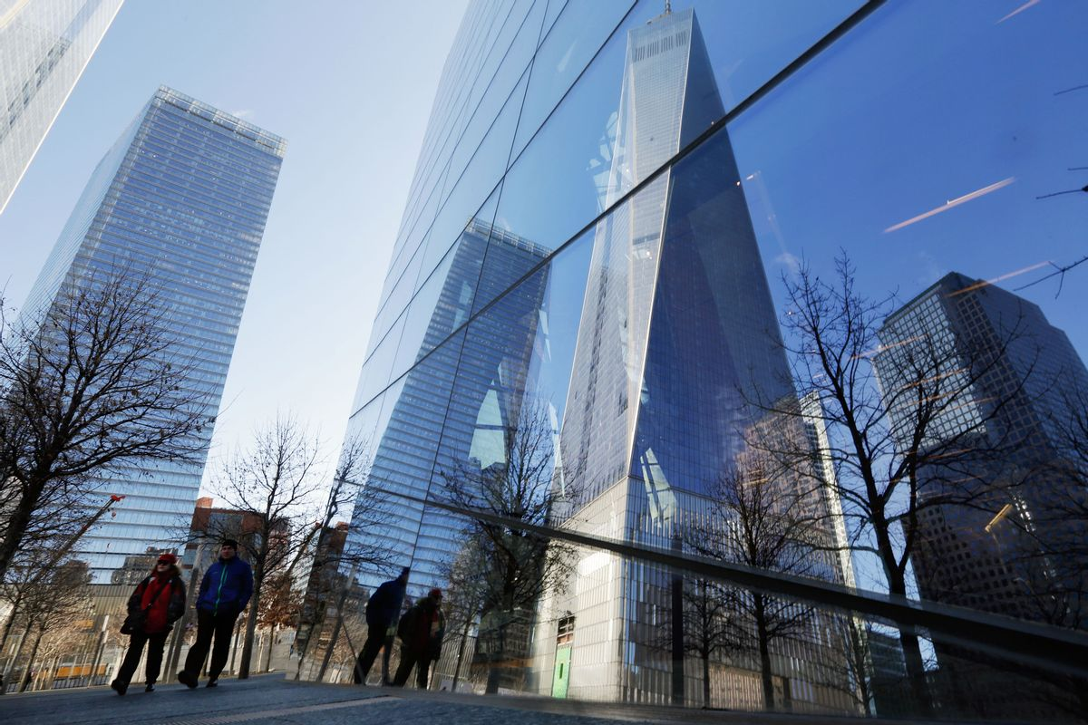The One World Trade Center building, second from right, is reflected in the windows of the 9/11 Museum, in New York,  Monday, March 23, 2015. The first stair-climb benefit will be held at One World Trade Center in May to raise money for military veterans, two foundations, the Stephen Siller Tunnel to Towers Foundation and the Captain Billy Burke Foundation, formed after the 9/11 attacks announced Monday. (AP Photo/Richard Drew) (AP)