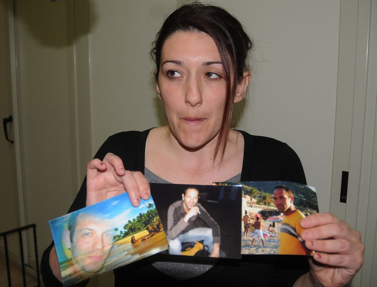 """Giovanna Piazza, Italian aid worker Giovanni Lo Porto's sister-in-law, shows Giovanni Lo Porto's pictures to the photographer in Palermo, Sicily, Italy, Thursday, April 23, 2015. The Italian government on Thursday deplored the death of an Italian aid worker in a U.S. air strike, calling it a """"fatal error"""" by the Americans. Italian Premier Matteo Renzi expressed his """"profound pain"""" over Giovanni Lo Porto's death and offered Italy's condolences to Lo Porto's family and that of American Warren Weinstein, who was killed in the same airstrike on the border between Pakistan and Afghanistan. Both were held hostage by al-Qaida. (AP Photo/Alessandro Fucarini) (AP)"""
