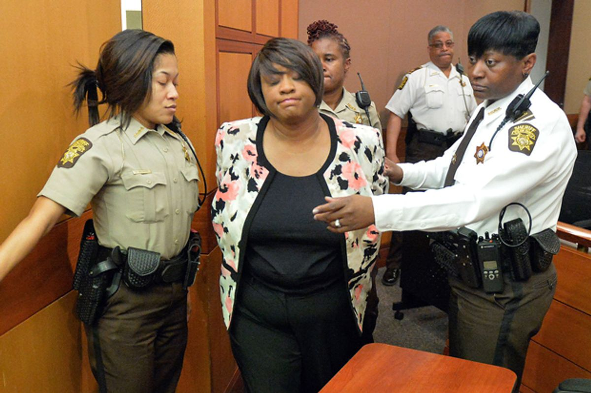 Former Atlanta Public Schools school research team director Tamara Cotman, center, is led to a holding cell after a jury found her guilty in the Atlanta Public Schools test-cheating trial, Wednesday, April 1, 2015, in Atlanta.       (AP/Kent D. Johnson)
