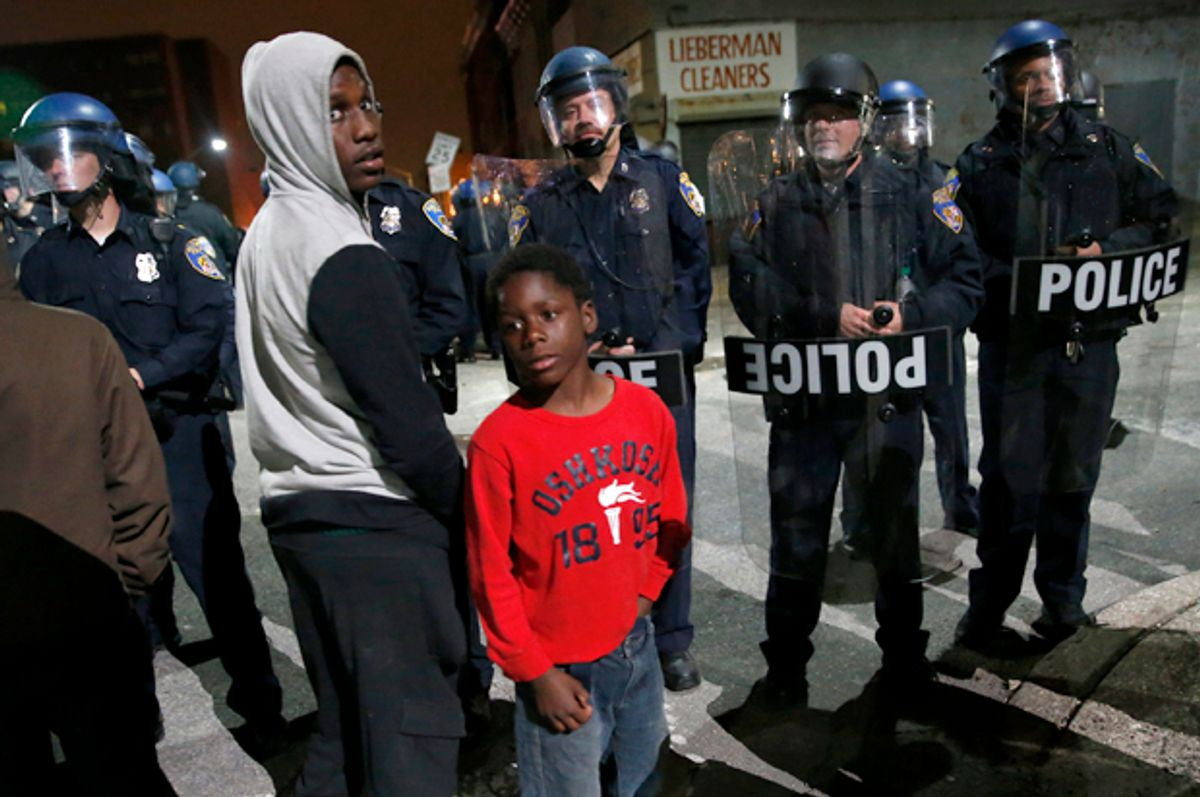 Police stand guard as protesters gather for a rally, Maryland April 25, 2015.        (Reuters/Shannon Stapleton)