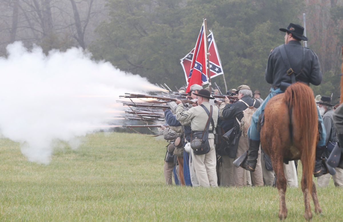 Confederate troops fire muskets at Union troops during a re-enactment of the Battle of Appomattox Courthouse as part of the commemoration of the 150th anniversary of the surrender of the Army of Northern Virginia at Appomattox Court House in Appomattox, Va., Thursday, April 9, 2015.  The battle was the final battle of the army of Confederate General Robert E. Lee before his surrender to Union troops.  (AP Photo/Steve Helber) (AP)