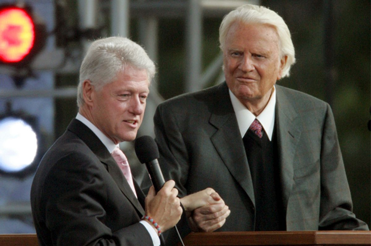 Former president Bill Clinton, left, speaks alongside the Rev. Billy Graham on the second night of the Greater New York Billy Graham Crusade Saturday, June 25, 2005 at Flushing Meadows Corona Park in New York borough of Queens. (AP Photo/Frank Franklin II)       (Frank Franklin Ii)