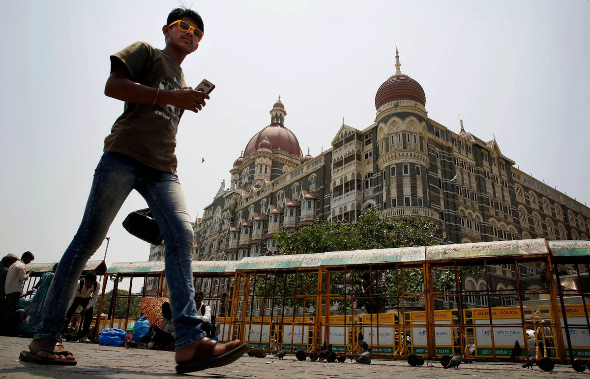 An Indian man walks outside the Taj Mahal hotel, which was one of the sites of the Mumbai terror attack, in Mumbai, India, Friday, April 10, 2015. A Pakistani court on Thursday, April 9, 2015, ordered the release of the main suspect Zaki-ur-Rehman Lakhvi in the 2008 Mumbai attacks for the second time in less than a month, a defense lawyer said. (AP Photo/Rajanish Kakade) (Rajanish Kakade)