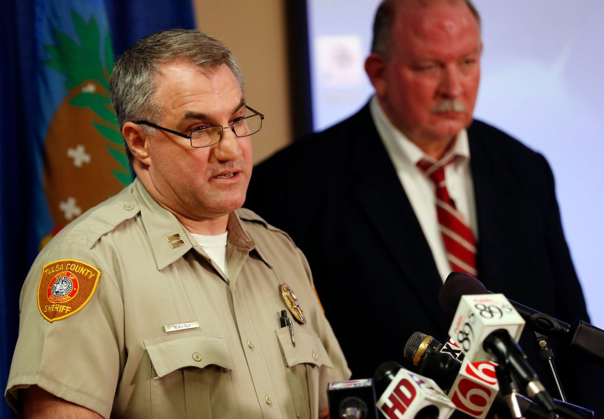 In this Friday, April 10, 2015, photo, Tulsa County Sheriff's Office Capt. Billy McKelvey, left, speaks next to Jim Clark, an independent consultant, during a news conference about the investigation of the death of Eric Harris in Tulsa, Okla. Police say a reserve sheriff's deputy thought he was holding a stun gun, not his handgun, when he fatally shot Harris during an arrest that was caught on video in Tulsa. (Cory Young/Tulsa World via AP) (AP)