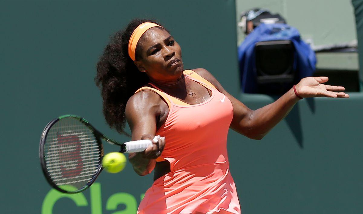 Serena Williams returns to Carla Suarez Navarro, of Spain, during the women's final at the Miami Open tennis tournament, Saturday, April 4, 2015, in Key Biscayne, Fla. Williams won 6-2, 6-0. (AP Photo/Alan Diaz)  (AP)