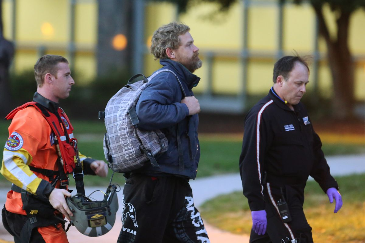 Louis Jordan, center, walks from the Coast Guard helicopter to the Sentara Norfolk General Hospital in Norfolk, Va., after being found off the North Carolina coast, Thursday, April 2, 2015. His family says he sailed out of a marina in Conway, S.C., on Jan. 23, and hadn't been heard from since. (AP Photo/The Virginian-Pilot, Steve Earley) (AP)