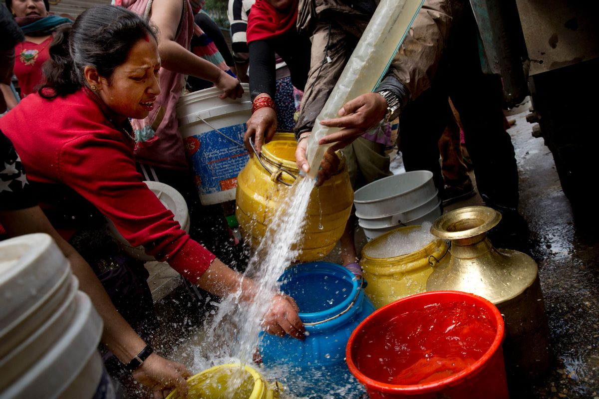 Nepalese collect water distributed in a tanker in Kathmandu, Nepal, Wednesday, April 29, 2015. While many villages across Nepal affected by Saturday's earthquake are still waiting for rescue and relief teams, life in the capital, Kathmandu, is slowly returning to normal. (AP Photo/Bernat Amangue) (Bernat Armangue)
