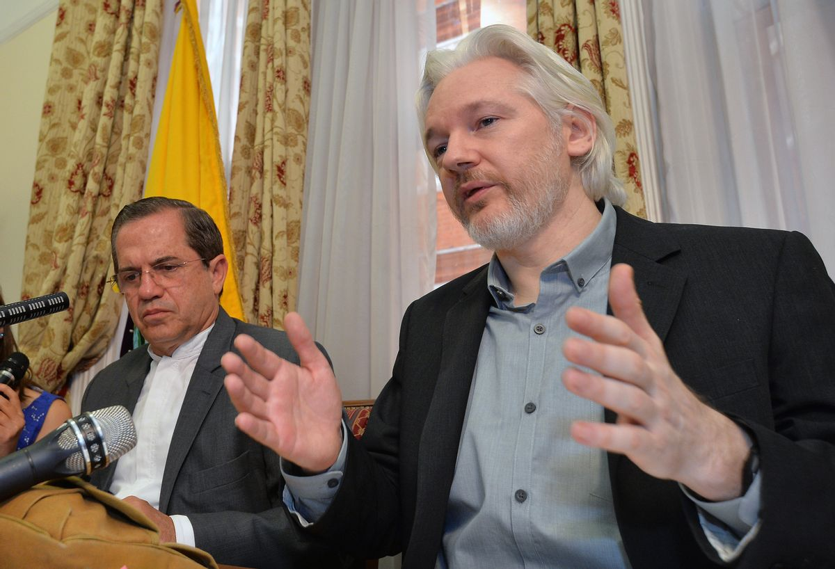 FILE - In this Aug. 18, 2014, file photo, Ecuador's Foreign Minister Ricardo Patino, left, and WikiLeaks founder Julian Assange speak during a news conference inside the Ecuadorian Embassy in London.  (AP)