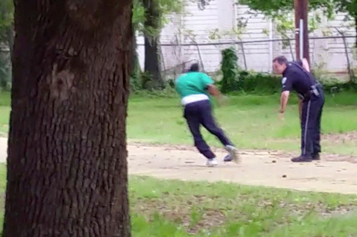 Michael Thomas Slager, right, pulls out his handgun as Walter Scott runs away from him, April 4, 2015, in North Charleston, S.C.         (AP/Courtesy of L. Chris Stewart)