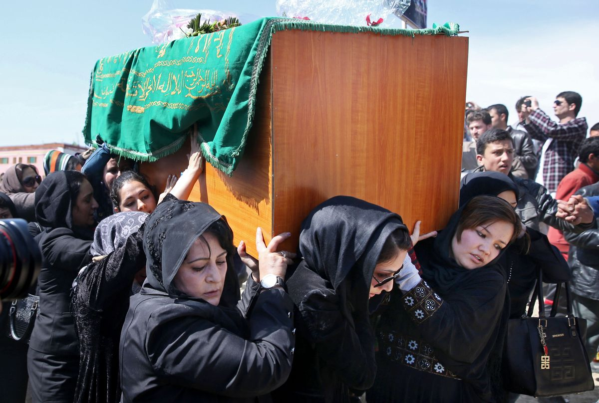 Afghan women rights activists carry the coffin of 27-year-old Farkhunda, an Afghan woman who was beaten to death by a mob.     (AP/Massoud Hossaini)