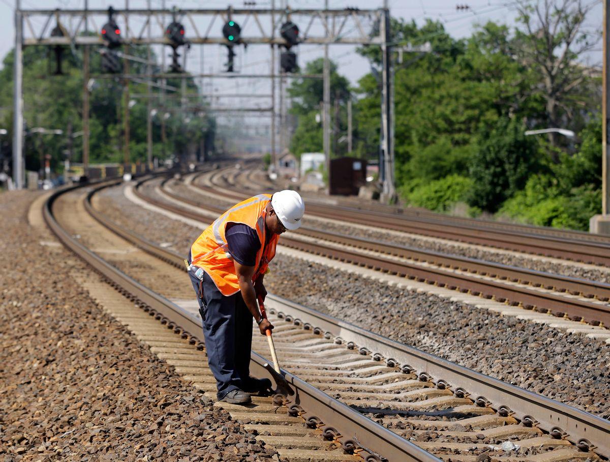 FILE - In this Thursday, May 30, 2013 file photo, Amtrak worker Rich Woolfolk checks railroad tracks along the Northeast Corridor in Elizabeth, N.J. (AP Photo/Mel Evans) (AP)