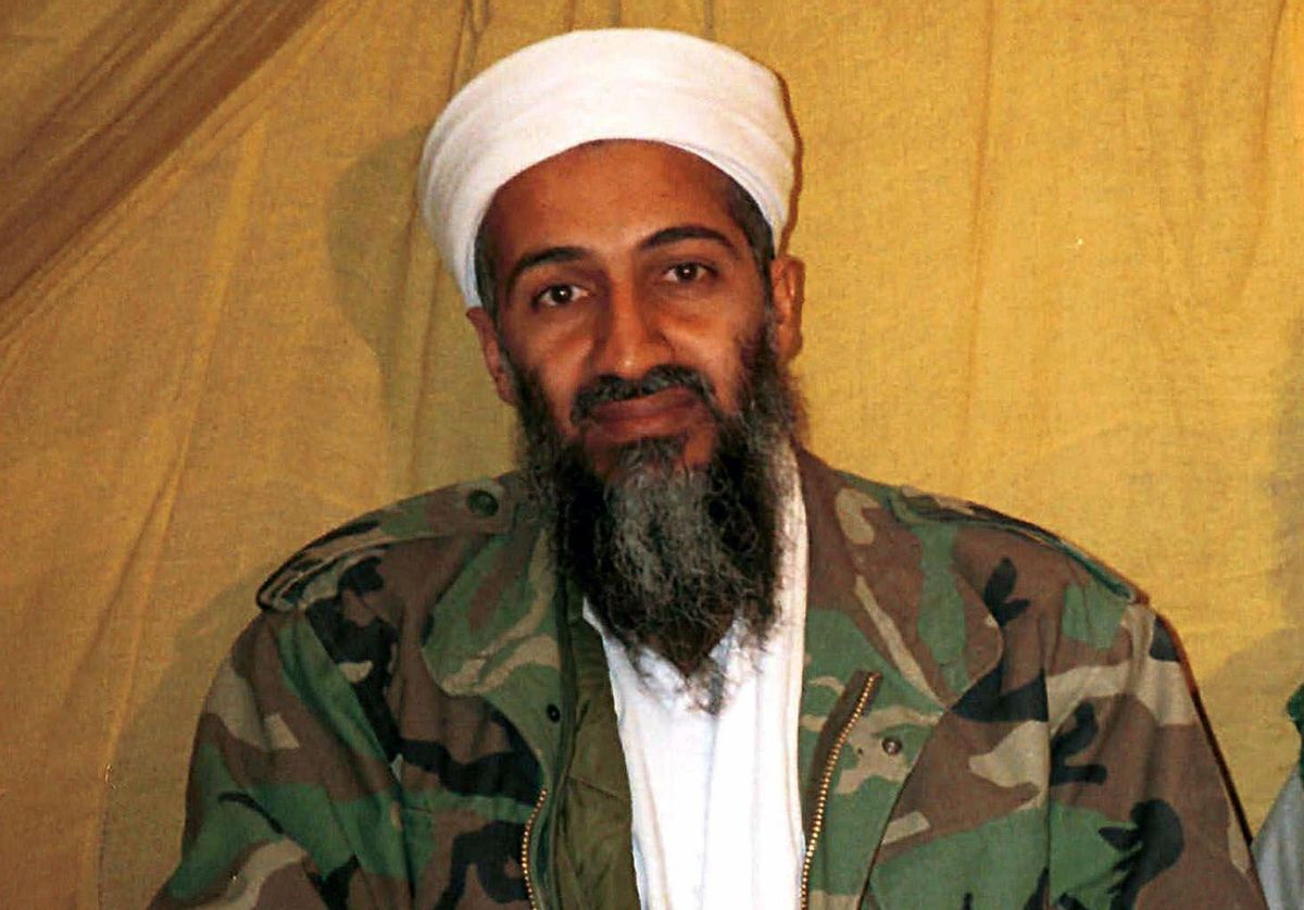 FILE - This undated file photo shows al Qaida leader Osama bin Laden in Afghanistan. U.S. intelligence officials have released more than 100 documents seized in the raid on Osama bin Laden's compound, including a loving letter to his wife and a job application for his terrorist network. The Office of the Director of National Intelligence says the papers were taken in the Navy SEALs raid that killed bin Laden in Pakistan in 2011.  (AP Photo, File)