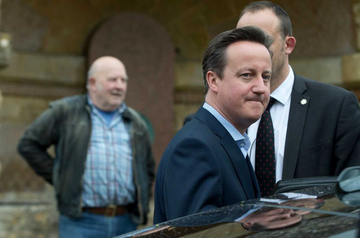 Britain's Prime Minister and Conservative Party leader David Cameron gets in his official car after voting at a polling station in Spelsbury, England, in the general election, Thursday, May 7, 2015. Polls have opened in Britain's national election, a contest that is expected to produce an ambiguous result, a period of frantic political horse-trading and a bout of national soul-searching.   (AP Photo/Alastair Grant) (AP)