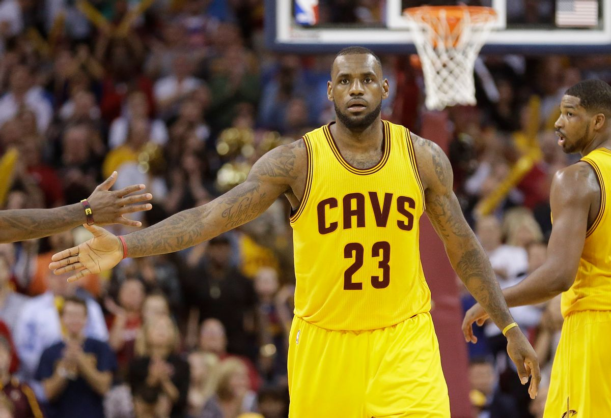 Cleveland Cavaliers forward LeBron James slaps hands with a teammate after scoring against the Chicago Bulls during the second half of Game 5 in a second-round NBA basketball playoff series Tuesday, May 12, 2015, in Cleveland. The Cavaliers won 106-101. (AP Photo/Tony Dejak) (AP)