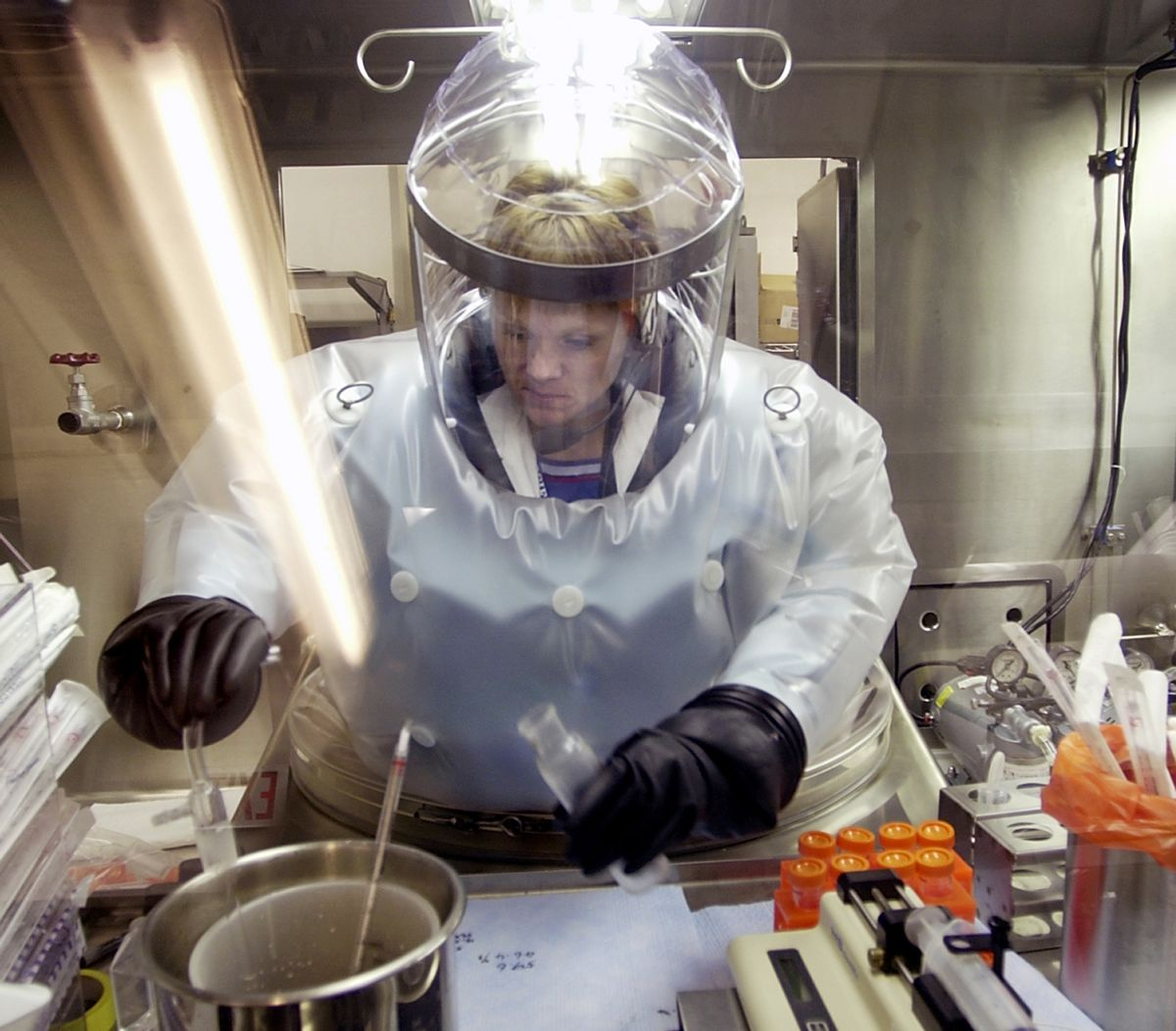 FILE - In this May 11, 2003, file photo, Microbiologist Ruth Bryan works with BG nerve agent simulant in Class III Glove Box in the Life Sciences Test Facility at Dugway Proving Ground, Utah. The specialized airtight enclosure is also used for hands-on work with anthrax and other deadly agents. The Centers for Disease Control and Prevention said it is investigating what the Pentagon called an inadvertent shipment of live anthrax spores to government and commercial laboratories in as many as nine states, as well as one overseas, that expected to receive dead spores. (AP Photo/Douglas C. Pizac, File) (AP)
