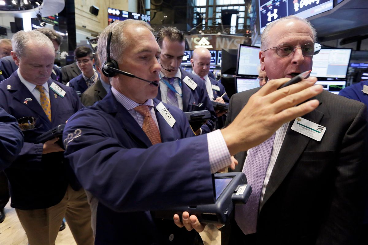 Trader Timothy Nick, center, works on the floor of the New York Stock Exchange, Tuesday, May 12, 2015. U.S. stocks are opening lower following declines in European markets. (AP Photo/Richard Drew) (AP)