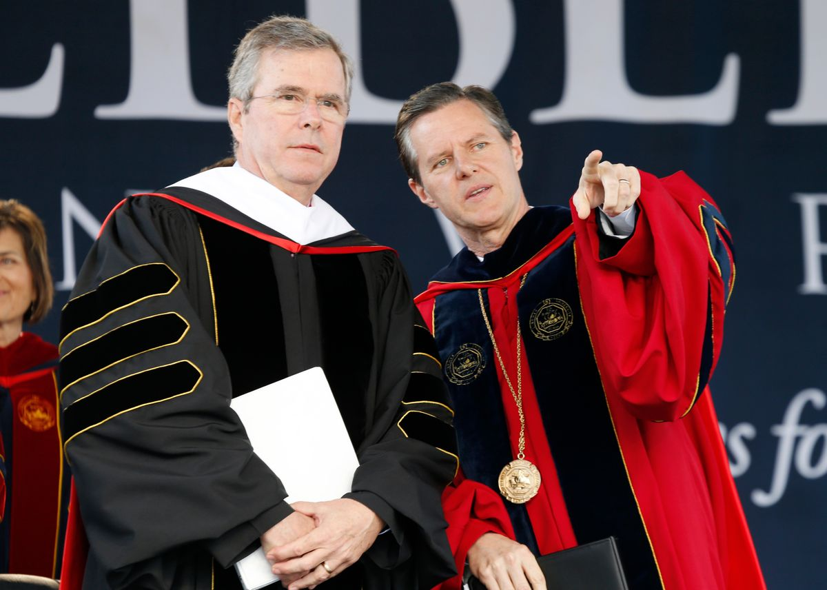 Commencement speaker former Florida Gov. Jeb Bush, left, arrives on stage with Liberty University president, Jerry Falwell Jr., for commencement ceremonies in Williams Stadium at the school in Lynchburg, Va., Saturday, May 9, 2015.   (AP Photo/Steve Helber) (AP)
