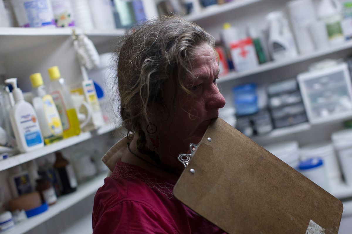 In this Thursday, May 7, 2015 photo, Victoria Goss, founder of Last Chance Corral, stands in the medical supply room as she waits for the result of a colostrum test in Athens, Ohio. Every new foal brought to rescue critical for the development of animal's immune system. In some cases, the foal is separated from the mother before the antibody transfer occurs, requiring intervention at the rescue. (AP Photo/John Minchillo) (AP)