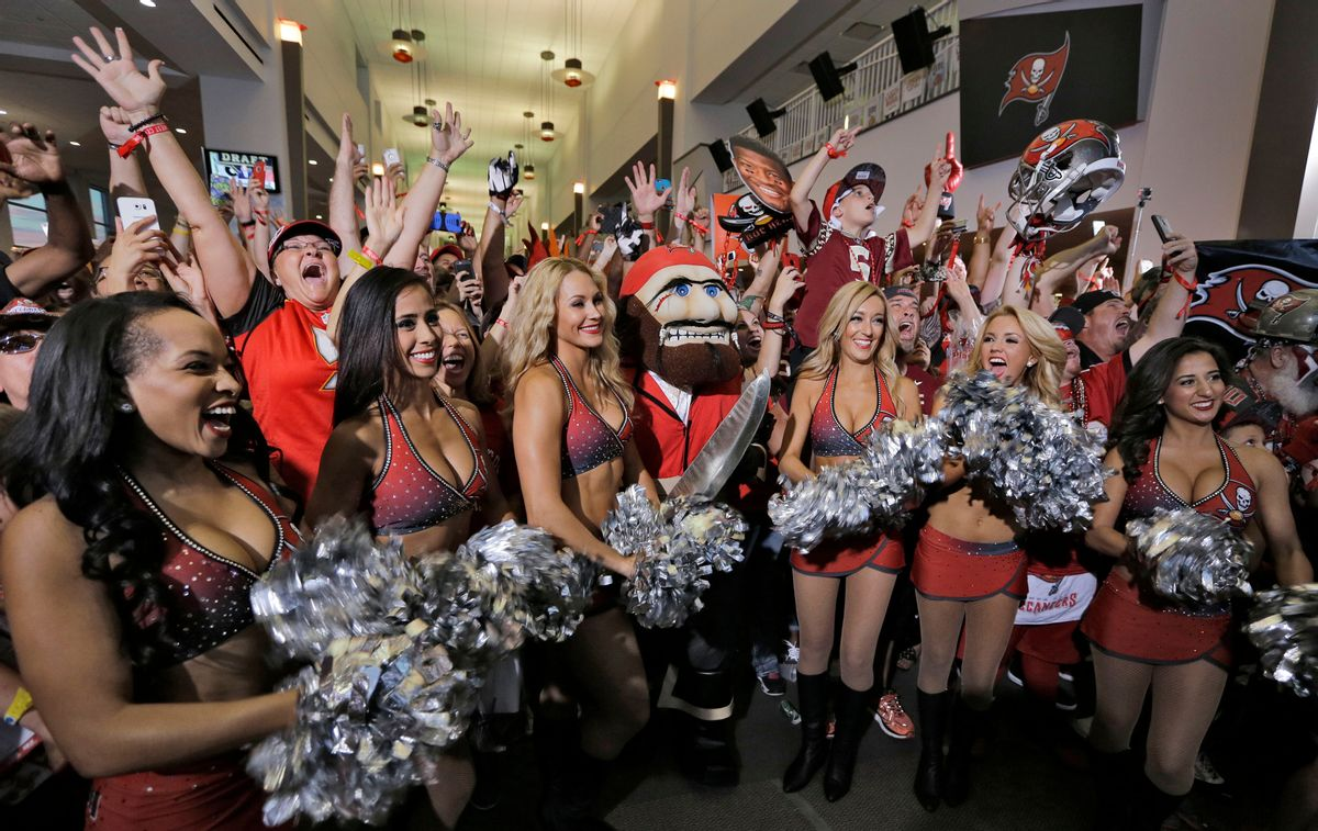 The Tampa Bay Buccaneers cheerleaders celebrate along with fans after the team drafted former Florida State quarterback Jameis Winston during an NFL draft party Thursday, April 30, 2015, in Tampa, Fla. Winston was the first overall pick in the draft. (AP Photo/Chris O'Meara) (AP)