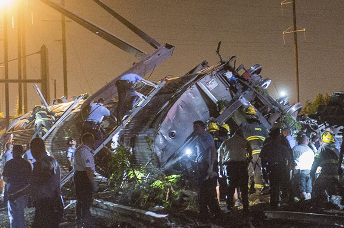 Rescue workers search for victims in the wreckage of a derailed Amtrak train in Philadelphia, Pennsylvania May 12, 2015.       (Reuters/Bryan Woolston)