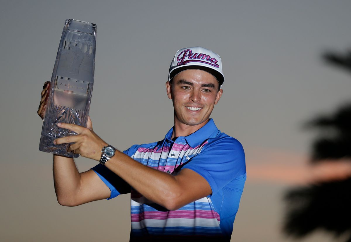 Rickie Fowler holds during the The Players Championship trophy, Sunday, May 10, 2015, in Ponte Vedra Beach, Fla. Fowler won in a sudden death playoff against Kevin Kisner. (AP Photo/John Raoux) (AP)